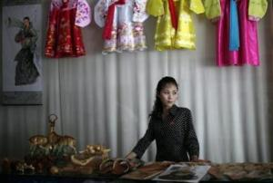 A woman stands in a gift shop in central Rason city, part of the special economic zone northeast of Pyongyang, in this August 30, 2011 file photo.  Credit: REUTERS/Carlos Barria/Files