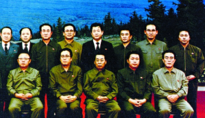 Kim Jong-il (bottom row, far left) with party leaders and Fujimoto (top row, far right) in December 1991. Photo by Fujimoto; AFP