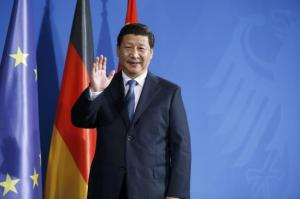China's President Xi Jinping waves to media following a joint news conference with German Chancellor Angela Merkel after an agreement signing, at the Chancellery in Berlin March 28, 2014.  Credit: Reuters/Fabrizio Bensch