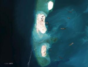 Dredgers reinforce a site being constructed on the westernmost part of Mischief Reef, located 216 km (135 miles) west of the Philippine island of Palawan, in this Center for Strategic and International Studies (CSIS) Asia Maritime Transparency Initiative satellite image taken on March 16, 2015 and released to Reuters on April 9, 2015. REUTERS/CSIS's Asia Maritime Transparency Initiative/Digital Globe/Handout