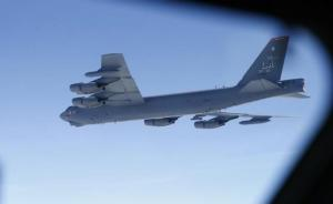 A U.S. Air Force B-52 is seen through the window of another during a training mission in the United Kingdom's airspace, June 17, 2014. REUTERS/Andrew Winning