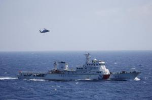 Chinese ship and helicopter are seen during a search and rescue exercise near Qilian Yu subgroup in the Paracel Islands, which is known in China as Xisha Islands, South China Sea, July 14, 2016. REUTERS/Stringer