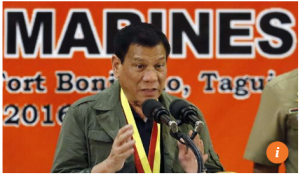 Philippine President Rodrigo Duterte speaks during his visit at the Philippine Marines headquarters in Taguig city, south of Manila on Tuesday. Photo: EPA