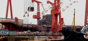 Radar being installed on finished hull of China's first homegrown aircraft carrier. Mil.huanqiu.com photo