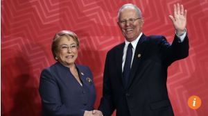 Chilean President Michelle Bachelet, left, and Peru's President Pedro Pablo Kuczynski shake hands upon arrival at the Lima Convention Centre during the Asia-Pacific Economic Cooperation summit in Lima on Saturday. Chile's vice-minister of trade says the nation is open to free trade options.Photo: AFP