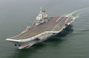 FILE - In this May 2012 file photo provided by China's Xinhua News Agency, Chinese aircraft carrier Liaoning cruises for a test in the sea. The Liaoning's political commissar Senior Captain Li Dongyou said China's first aircraft carrier is now ready to engage in combat, marking a milestone for a navy that has invested heavily in its ability to project power far from China's shores. (Xinhua, Li Tang, File/Associated Press)